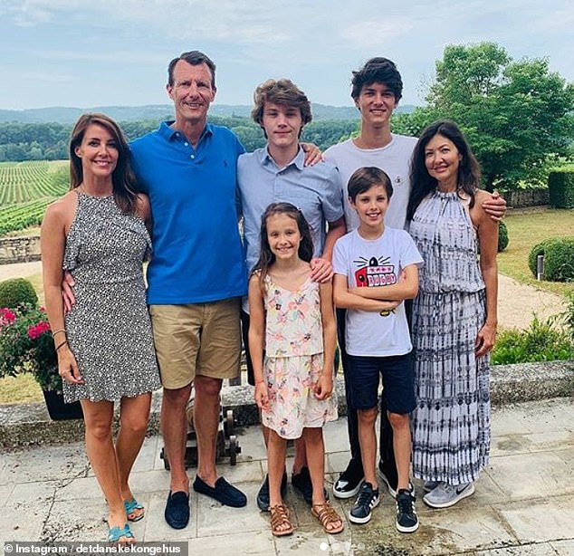 In this picture taken days before his health scare in France this summer, Prince Joachim is seen with Princess Marie, Princess Athena, eight, (front), Prince Felix, 18 (centre), Princess Nikolai, 21, Prince Henrik, 11 and his ex-wifeCountess Alexandra of Frederiksborg