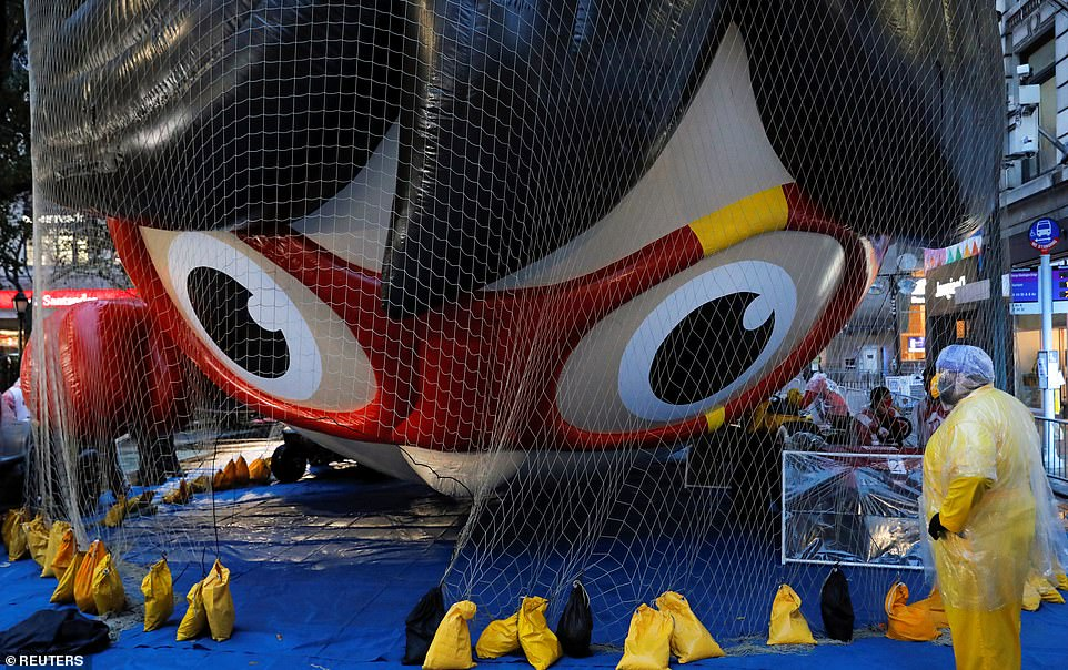 A balloon depicting Red Titan, a character from 'Ryan's World', is seen ahead of the 94th Macy's Thanksgiving Day Parade