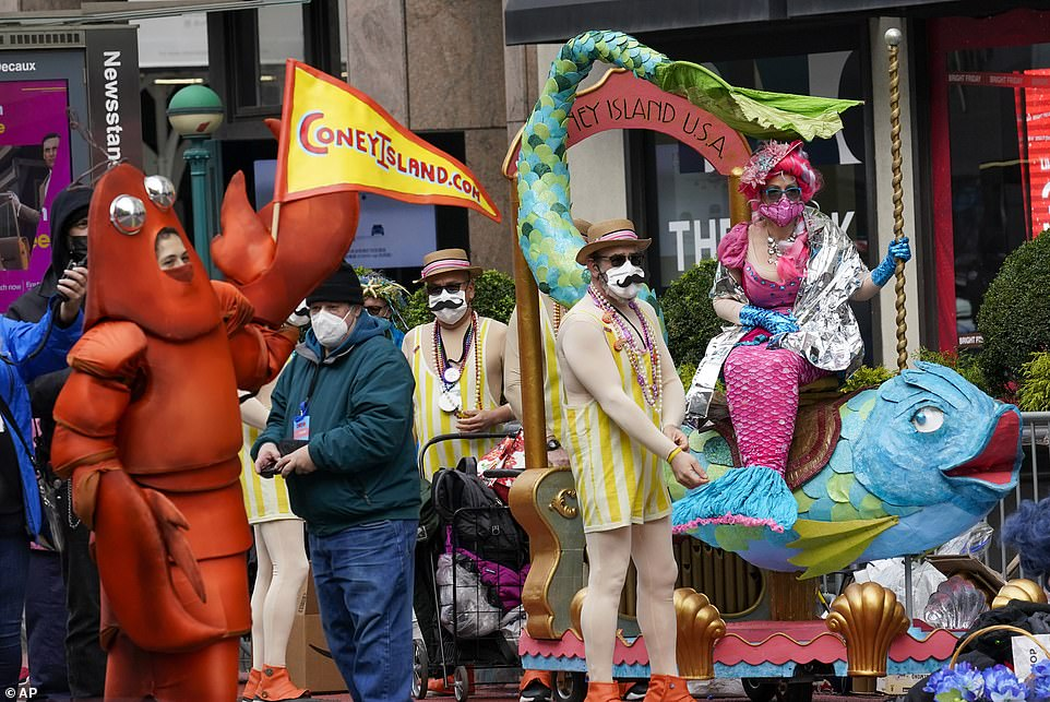 Entertainers celebrating the famous Coney Island beach were seen waiting along the sidewalk for their turn to perform in creations ranging from a lobster suit to a mermaid sitting on top of a fish as they filmed Wednesday