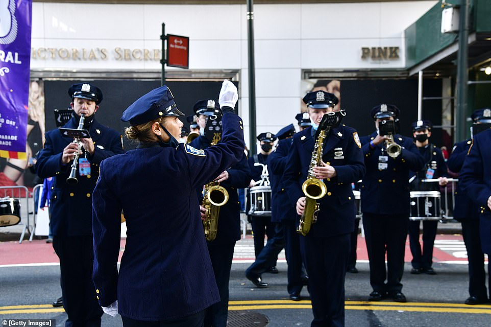 Conductor leads the NYPD Police Band as they line up to march at the 94th Annual Macy's Thanksgiving Day Parade