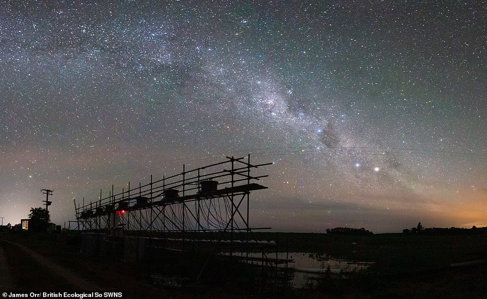 Constant Flow -James Orr.This photograph is a panorama made up of multiple long-exposure photographs of the Milky Way above an experimental stream system made up of 128 mesocosms. Student winner Ecology in Action