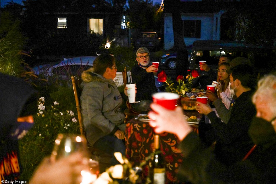 Los Angeles, California: People dine while sitting at socially distanced tables during Thanksgiving