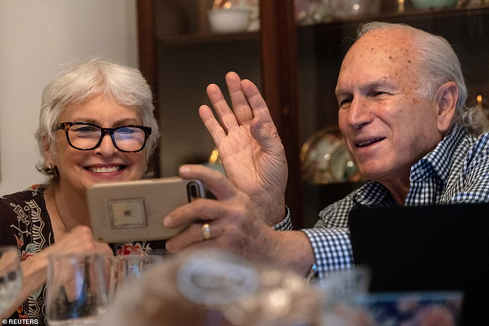 Detroit, Michigan: Janis and Uri Segal celebrate Thanksgiving with a virtual zoom with their family before a small dinner together, as they try to prevent the spread of coronavirus