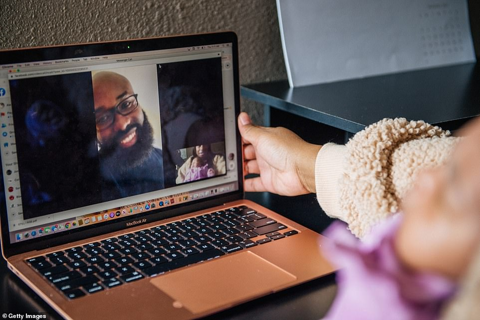 Los Angeles, California: Alexis Small and her newborn baby Aubrielle Kitchen meet with her brother Brandon over a Zoom Conference call on Thanksgiving