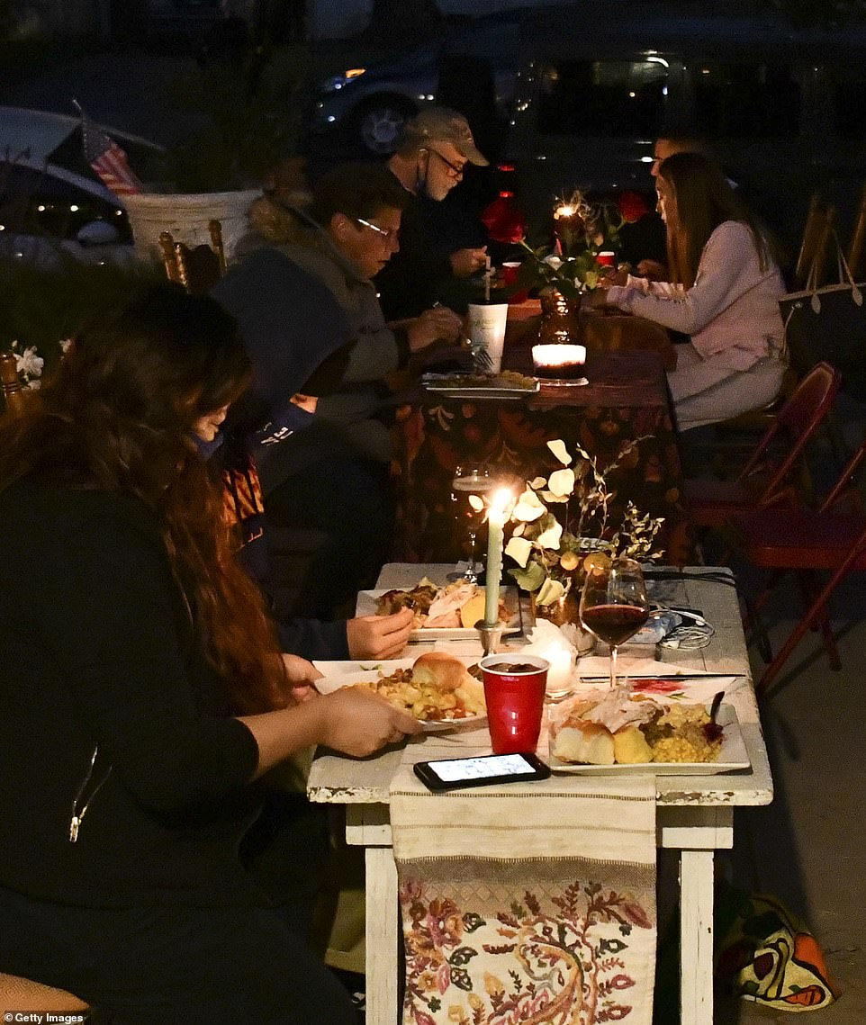 Los Angeles, California: People are seen dining out while sitting at socially-distanced tables on Thursday