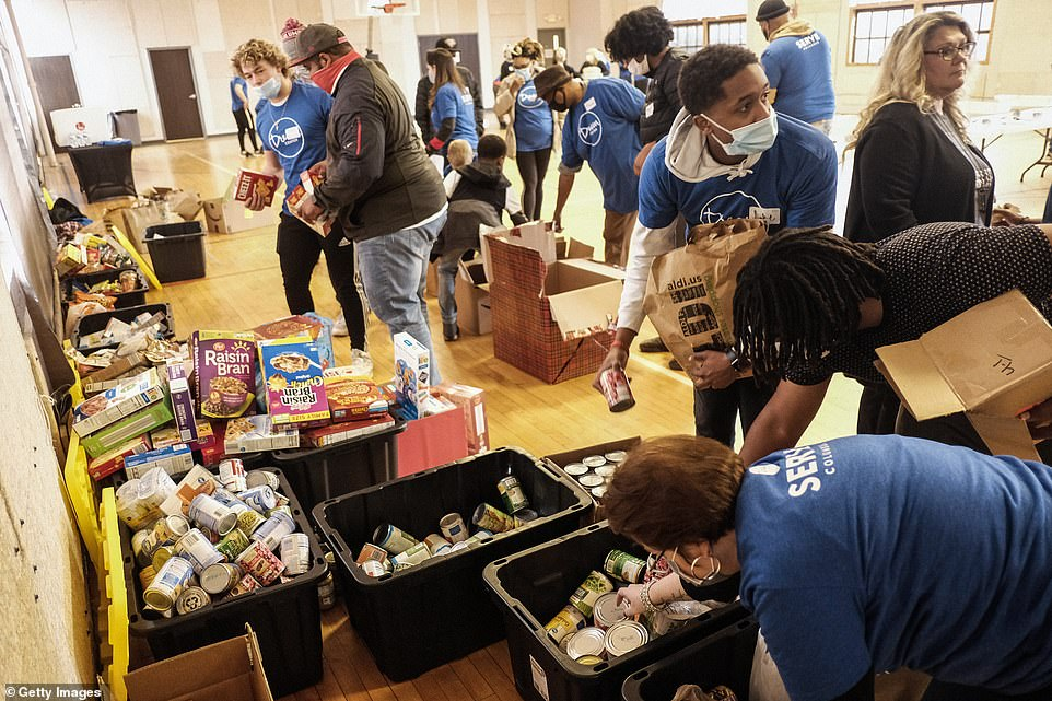 Columbus, Ohio: Volunteers at Rock City Church prepare meals and other items such as hand warmers and hand sanitizer to hand out to those in need during a Thanksgiving beneficiary event on Thursday