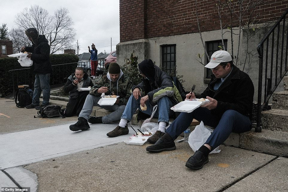 Columbus, Ohio: Residents are seen enjoying boxed hot Thanksgiving meals during the beneficiary event on Thursday