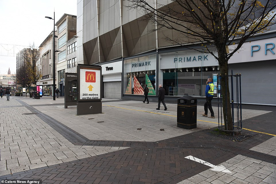 A handful of people walk through Birmingham city centre this morning on what would normally be a busy Black Friday