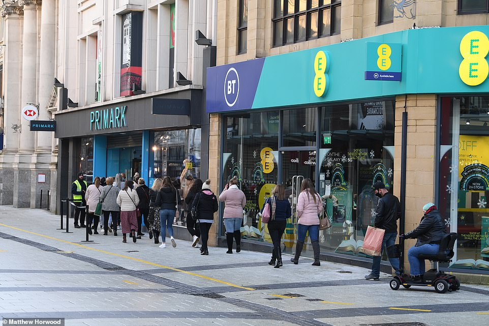 People queue outside a Primark store in Cardiff city centre on Black Friday today. Non-essential shops can open in Wales