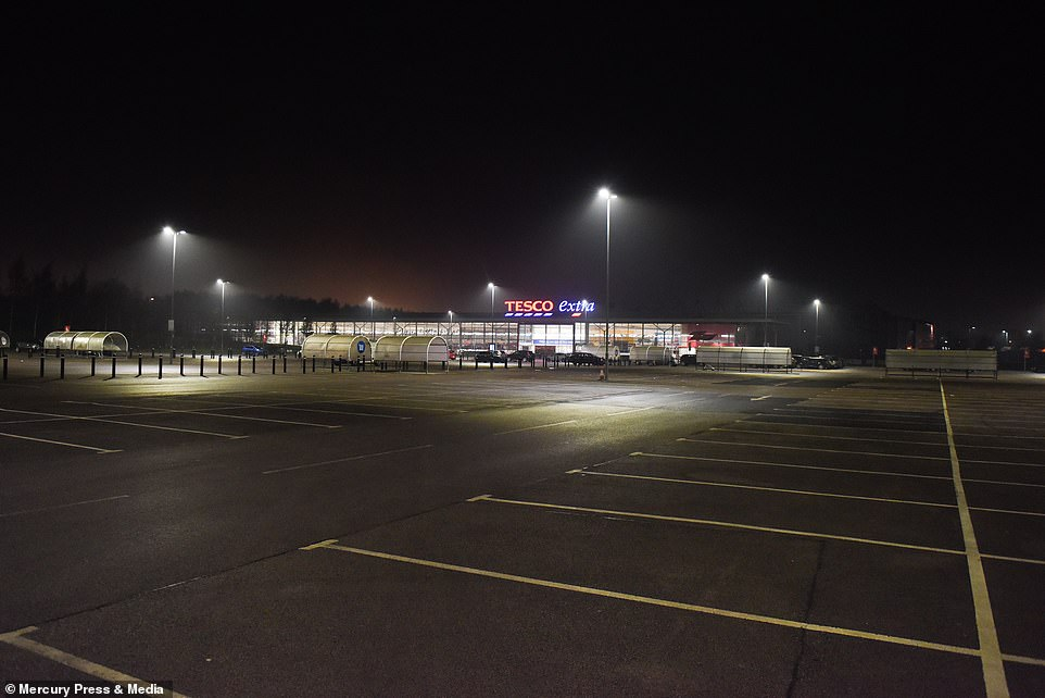An empty car park at Tesco Extra in St Helens, Merseyside, before dawn this morning Black Friday begins this year