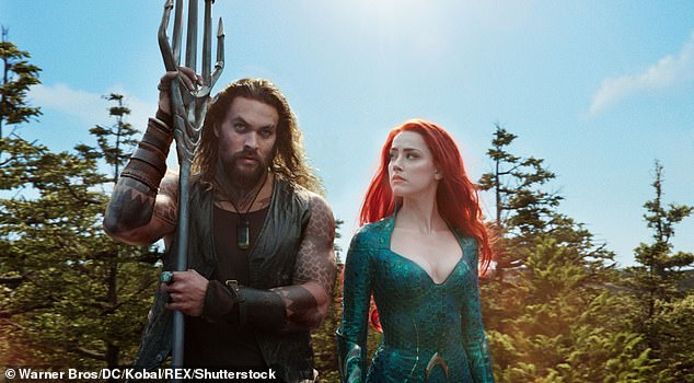 Fans have demanded Heard (right), pictured as 'Hera' in Marvel's Aquaman, be fired after she and Depp launched domestic abuse allegations at each other