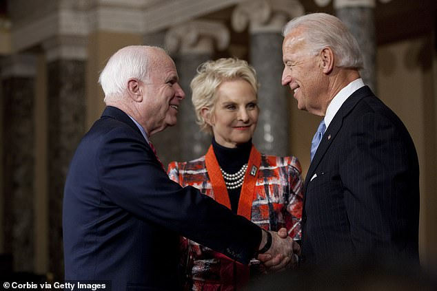 From left: Then-Senator John McCain, Cindy McCain, and then-Vice President Joe Biden are seen on Capitol Hill in this 2011 photo