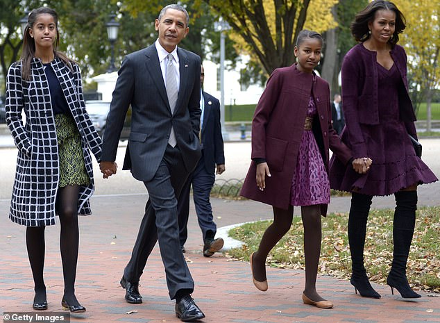 Family of four: His 'household' includes his wife Michelle Obama and their daughters Malia, 22, and Sasha, 19, with whom he is pictured in October 2013