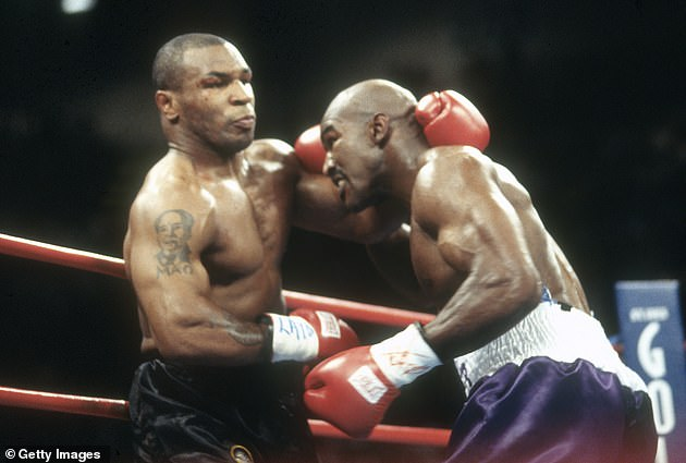 Evander Holyfield (right) says if Tyson (left) can catch Jones Jr then he is going to hurt him