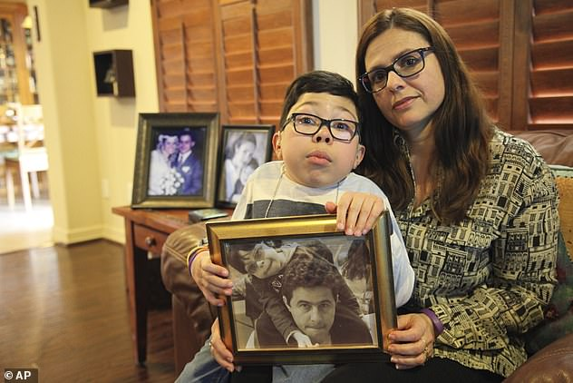 Maria Elena Cardenas is pictured with her son Sergio, who has been suffering nightmares since his father, Gustavo, was arrested in 2017