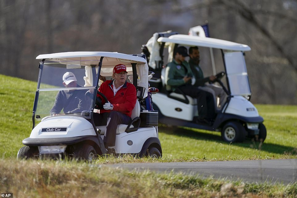 The president was joined by his two eldest sons Eric and Don Jr., ,who were making a rare appearance on the golf course