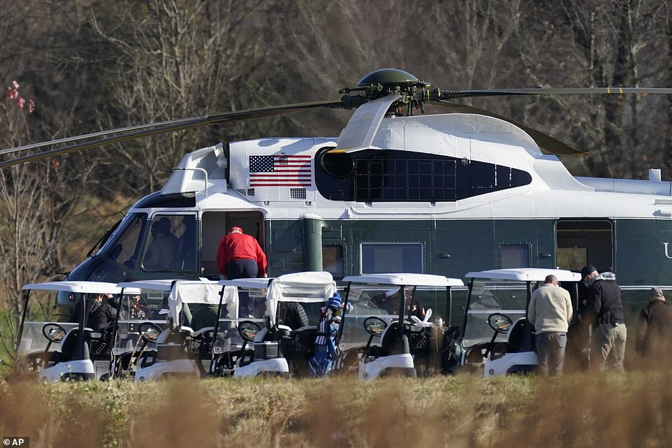 Trump is seen leaving the golf course again for the presidential retreat at Camp David