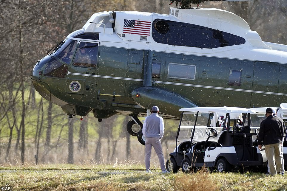 Marine One with President Donald Trump aboard lands at Trump National Golf Club on Saturday