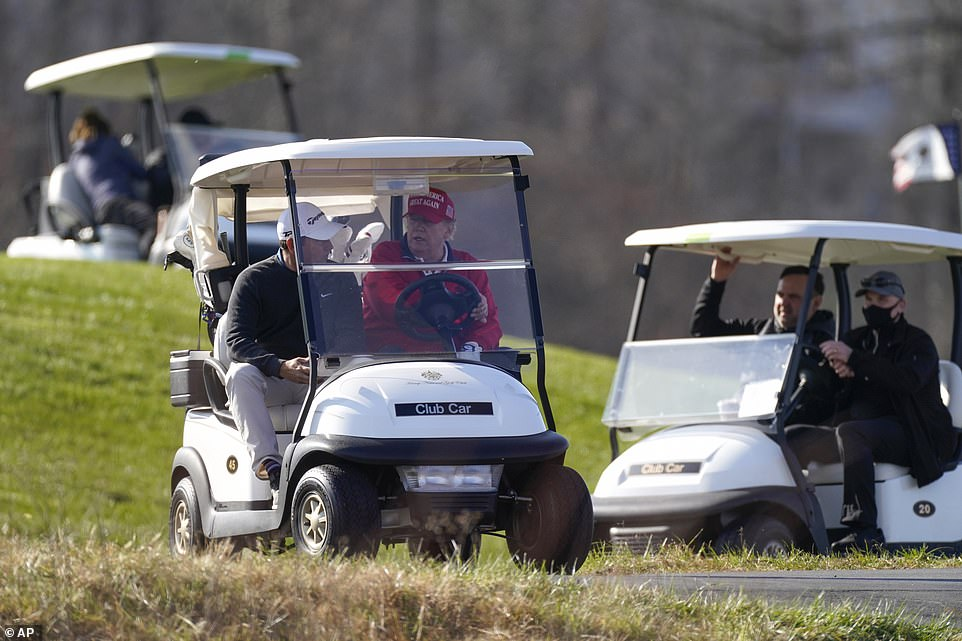 President Trump leads the way as he and his sons enjoyed a round of golf on Saturday morning
