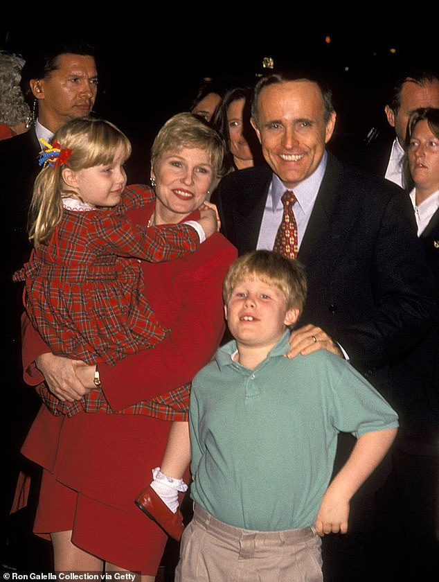 While Caroline has defected to the Democrats, her older brother, Andrew, is more in lockstep with their dad. He currently works as the Public Liaison Assistant to President Trump. The siblings are pictured with their dad and mom as children in the 1990s