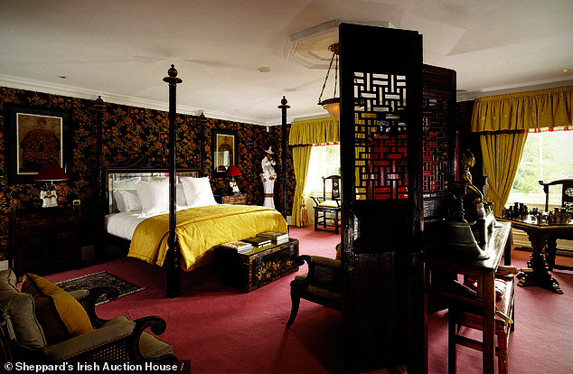 In the enormous range of eclectic items on offer in the auction were some mounted gazelle heads, suits of armor, some decommissioned guns, zebra-fur framed mirrors and a set of bamboo parasols. Pictured: An elaborately designed room in his expansive home