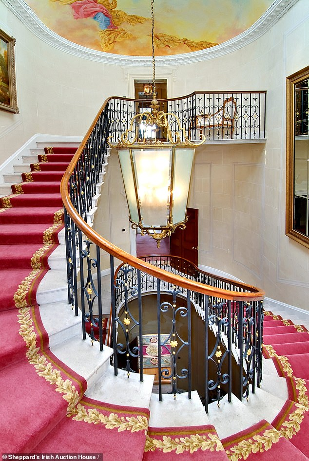 Flatley bought the 12-bedroom property, Castlehyde House in Fermoy, for ¿4m 21 years ago. Pictured: The impressive round carpeted staircase