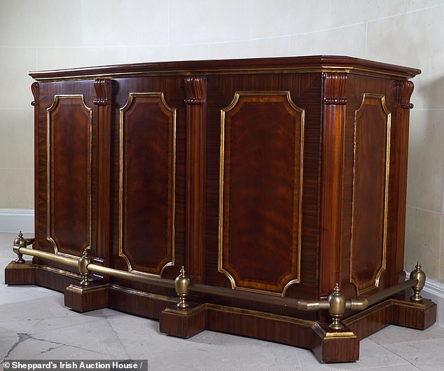The Mahogany bar unit with a marble and brass top (pictured) garnered some fierce bidding before the gavel went down at almost £7,300 - well over the £4,500 estimate