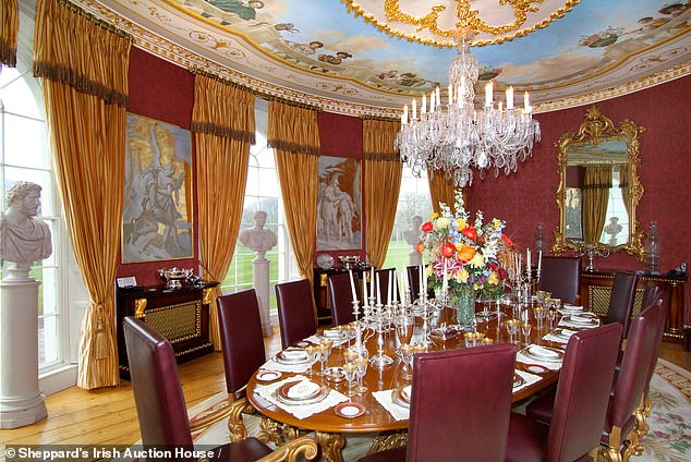 The large dining room is big enough to fit a 14-person table inside and boasts of an elaborate mural on the ceiling