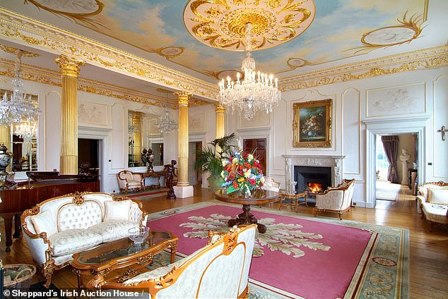 In the spacious rooms, grand chandeliers hang from the ceiling alongside golf detailing and more ceiling murals