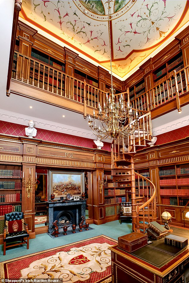 Inside the impressive estate is an enormous library filled with shelves of books on dark wood bookcases