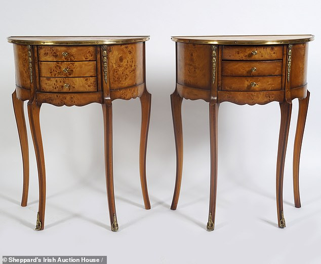 Inlcuded in the enormous auction list were a pair of gilt tables with marble tops (pictured)