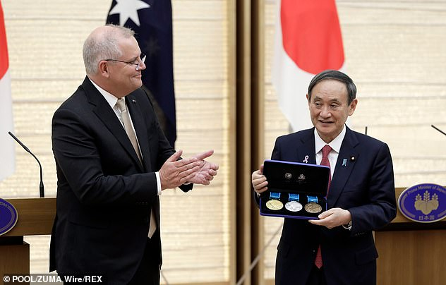 Mr Morrison visited Japanese Prime MinisterYoshihide Suga (pictured together) last week amid rising tension with China