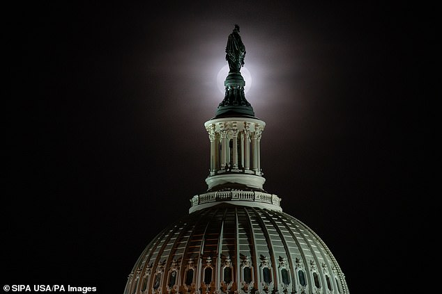 The Beaver Moon rises over the Capitol in Washington DC