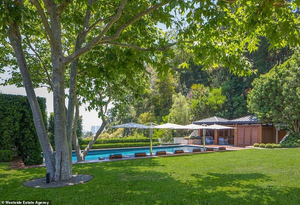 He likes to work hard: Seacrest has been called the hardest working man in showbiz thanks to juggling several projects at once; here is a look at the swimming pool with views of LA