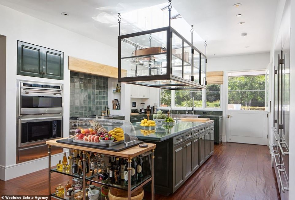 A good place to bake cookies: The kitchen is perfect for a master chef who needs to whip up a gourmet meal for 20. The feel is airy with high ceilings and there are all the best appliances with two ovens and plenty of ranges