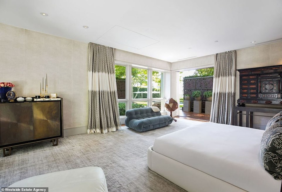 Sweet dreams in this dreamy space: The master bedroom is large with corner windows that look out to the back yard