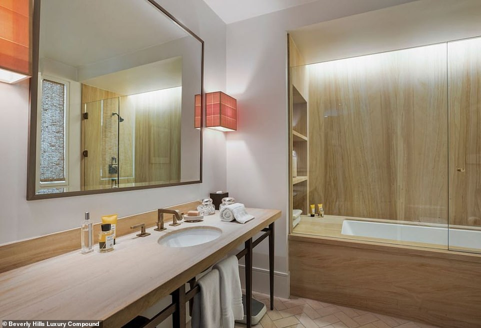 A woodsy feel in the guest bathroom: Here is a look at another bathroom that has wood walls by the tub and a wood counter top with a minimalist mirror