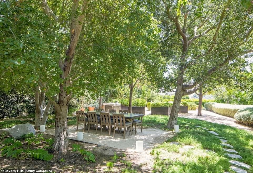Another place to have an al fresco dinner: This dining space is surrounded by mature trees and a paver walkway