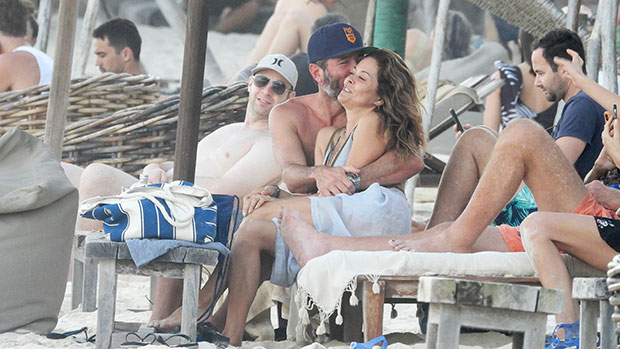 Brooke Burke, 49, Rocks Sexy Bikini & Packs On the PDA With BF Scott Rigsby At The Beach – Pics
