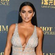 Abigail Ratchford without clothes, covers her nakedness with one hand and takes a photo | The State