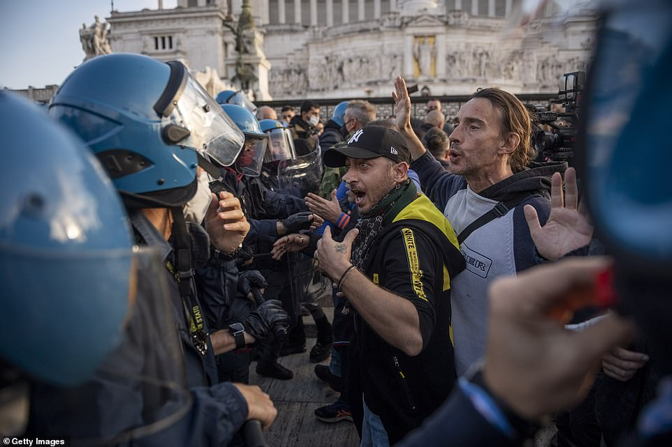 Anti-lockdown demonstrators clash with police in Italy and French Catholics demand right to worship