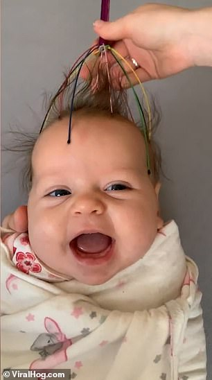Blissed out! Adorable moment baby gurgles and smiles when she is given a massage