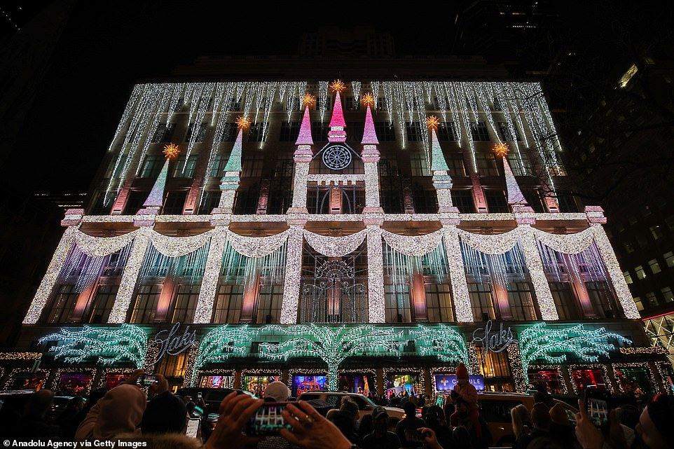 Christmas comes to pandemic-ridden NYC: Crowds flock to see Saks' windows and buy Christmas trees
