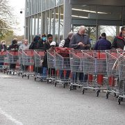 Did someone say LOCKDOWN? Panic-buyers form train of trolleys outside Sainsbury's and Costco