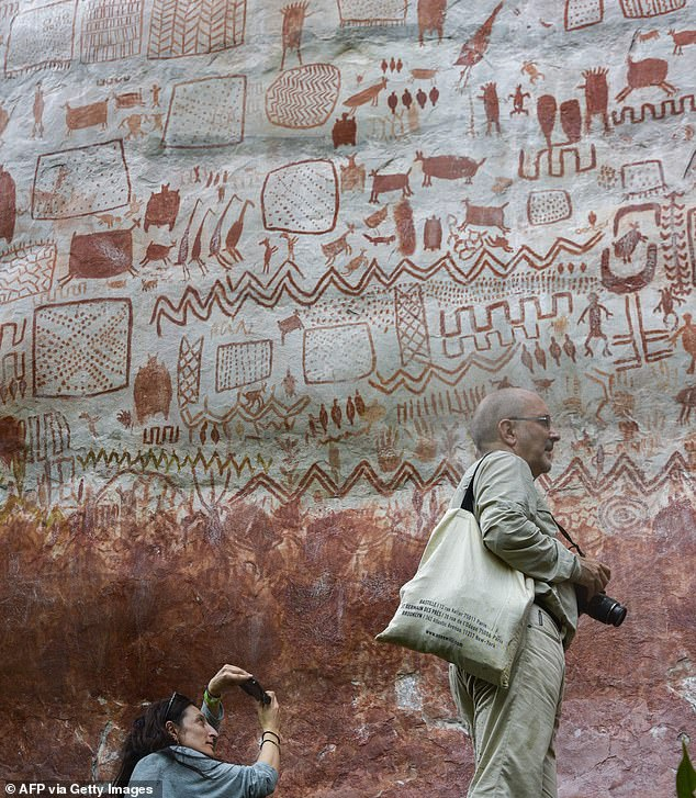 Eight-mile wall of prehistoric paintings of animals and humans is discovered in Amazon rainforest