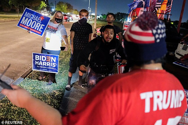 Houston, Texas: Biden supporters face off a Trump supporter outside of a polling site Tuesday