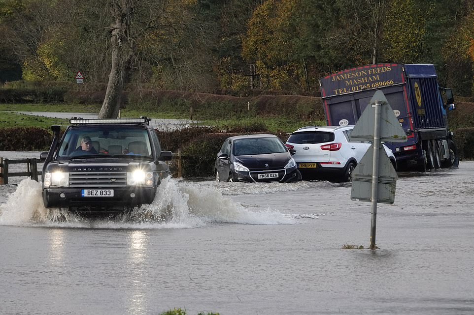 Flooding chaos as firefighters use boats to rescue stranded motorists in North Yorkshire