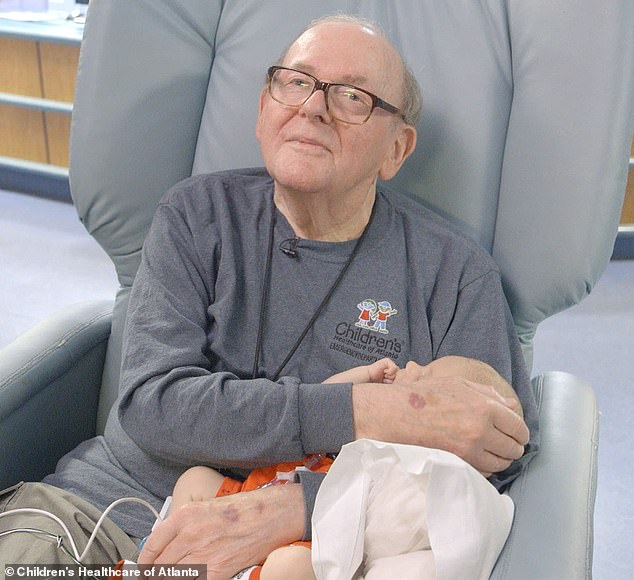 ICU grandpa who cuddled hospital babies for 14 years dies of cancer at age 86