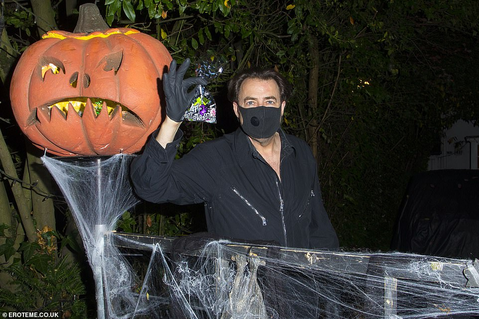 Jonathan Ross has a more subdued Halloween as he greets trick-or-treaters at his home