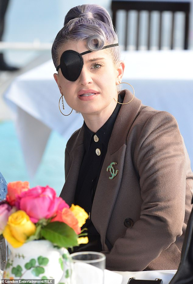 Kelly Osbourne turns her eye patch into a fashion statement as she grabs lunch with pals